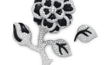 A DIAMOND AND ONYX FLOWER BROOCH AND LEAF PIN, BY CHANEL