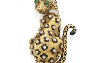 Gold, Enamel, Diamond and Emerald Clip-Brooch, David Webb Designed as a leopard, the spots applied with black enamel and accented with bezel-set round diamonds, the eyes set with cabochon emeralds