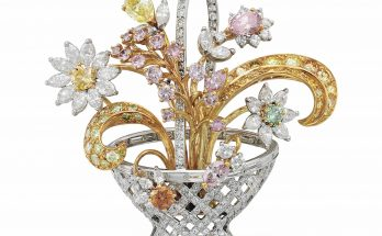 A COLORED DIAMOND AND DIAMOND BROOCH