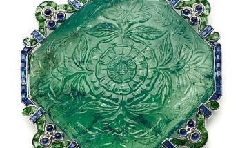 Carved emerald brooch by Cartier
