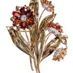 GARRARD LOW KARAT GOLD, DIAMOND & GARNET FLOWER BROOCH