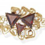 A garnet and diamond brooch, by George Weil, circa 1970