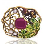 A GARNET, SEED PEARL AND ENAMEL BROOCH, BY LOUIS COMFORT TIFFANY