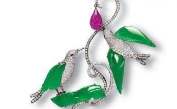 A JADEITE, DIAMOND AND RUBY CLIP BROOCH