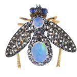 A gem-set bee brooch.