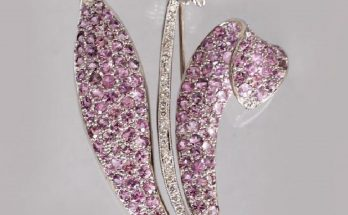 AN 18CT WHITE GOLD SCOTTISH THISTLE STYLE BROOCH set with diamonds, pink sapphires and lemon citrines.