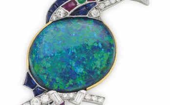 A BLACK OPAL, MULTI-GEM AND DIAMOND 'KINGFISHER WITH FISH' BROOCH, BY CARTIER