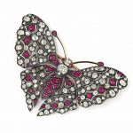 A RUBY AND DIAMOND BROOCH Modelled as butterfly