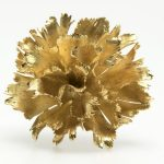A gold carnation flower brooch, Meister