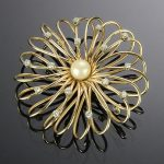14K Gold tested wire basket pin with a 7mm natural pearl and 15 round brilliant cut diamonds